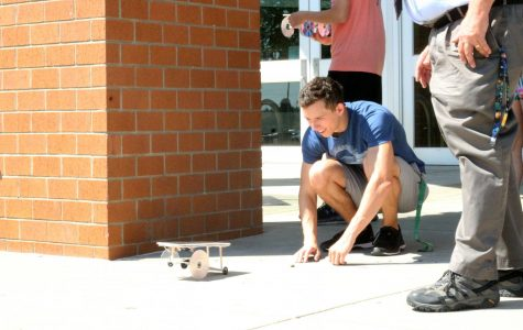 Senior Brady Gebbie tests his Mars Rover in front of the school during astronomy.