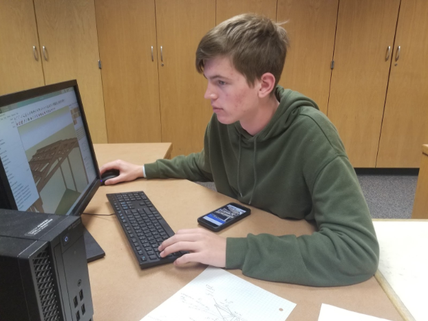 Senior+gage+Heithold+working+on+designing+the+LSW+pavilion+for+CAD+architecture.