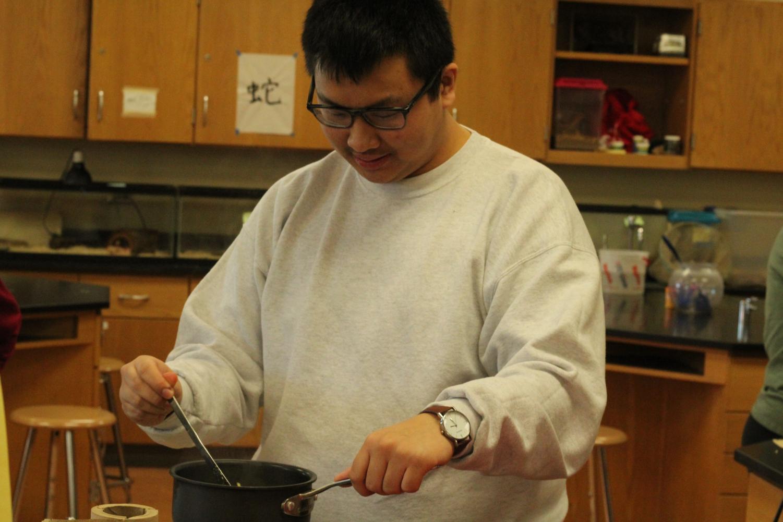 Junior Andy Vo of Asian Caucus prepared his ramen noodles.