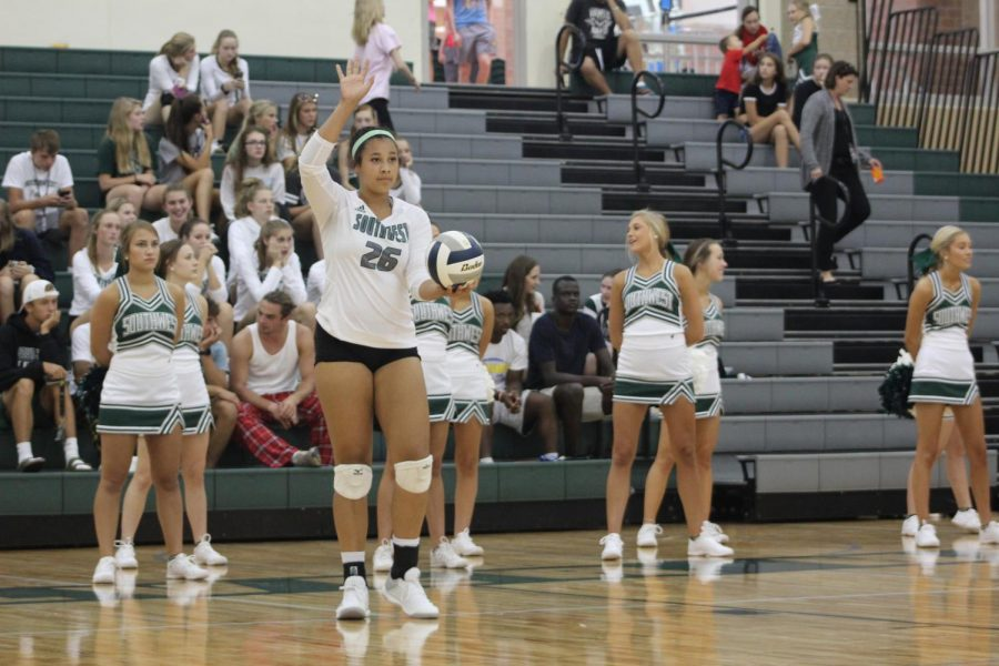 Senior Jaden Ferguson gets ready to serve in one of many games that lead to the district play offs.