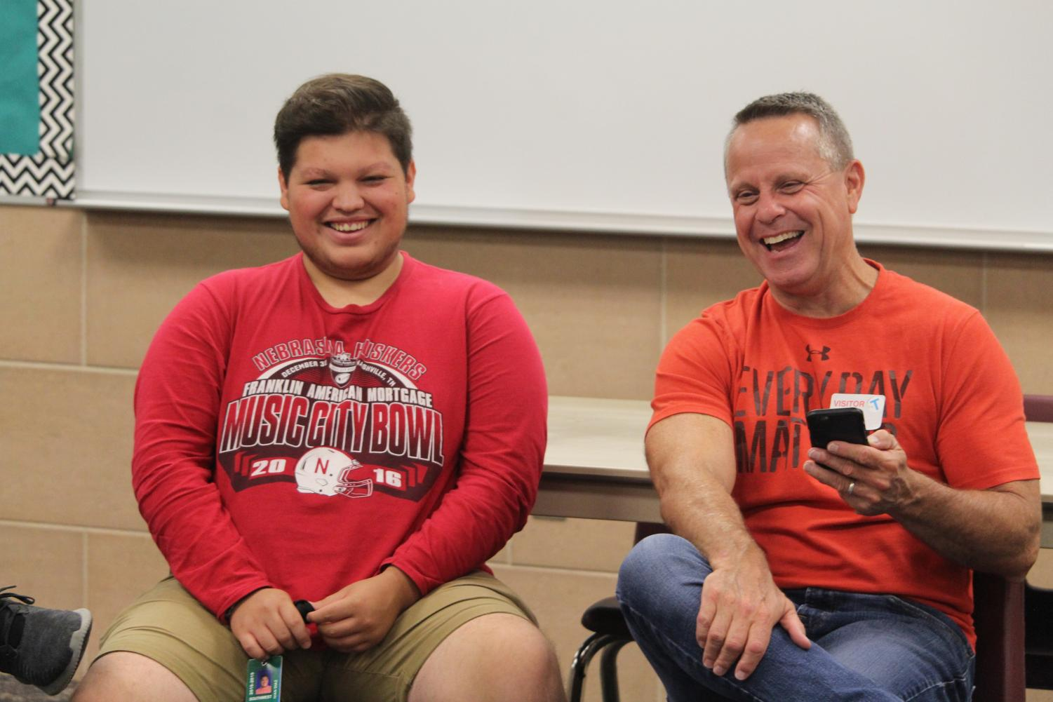 Southwest Senior Ivan Diaz and Mr. Bruce Riddle laugh during discussion time at Kaleidoscope club.