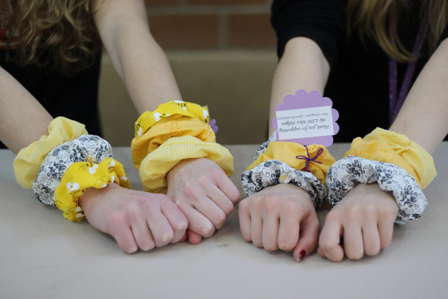Hive Helpers made and sold scrunchies to fund garden behind school. The club meets every Wednesday at 7:45 a.m. in room A107.
