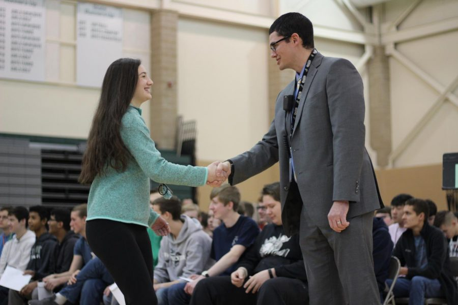 Sophomore+Ava+Spinar+shakes+Principal+Michael+Gillotti%27s+hand+during+Honors+Convocation+on+Thursday%2C+Feb.+21.