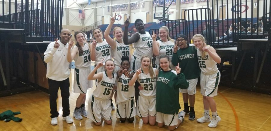LSW+Freshman+girls+basketball+team+celebrates+their+victory.+The+girls+won+the+LPS+championship+Tuesday+night%2C+52-48.+