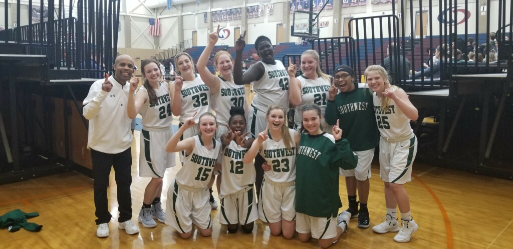 LSW Freshman girls basketball team celebrates their victory. The girls won the LPS championship Tuesday night, 52-48.