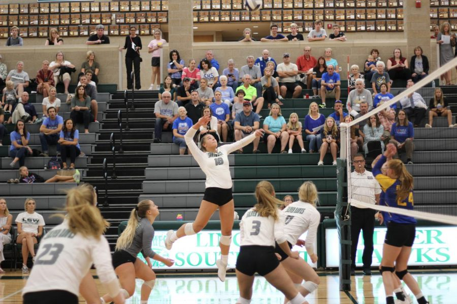 Sophomore Shaylee Myers goes up to spike the ball at Seward. The hawks won their game against Seward 2-0.