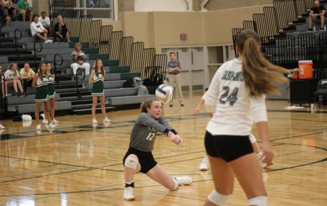 Makenzie Painter passes the ball in the JV game against Kearney. The Hawks won their game 2-1.