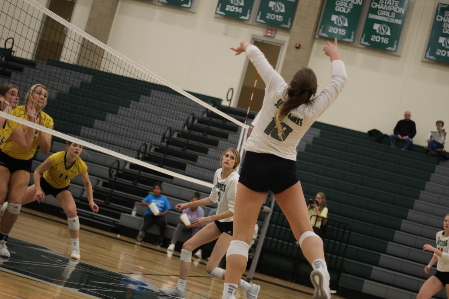 Sophomore Shaylee Myers spikes the ball to the opposing team. Southwest lost to Pius X 3-0 sets in the HAC Tournament.