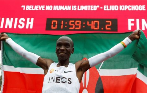 Eliud Kipchoge celebrating after his 1:59:40.2 effort early in the morning in Vieana, Austria on October 12, 2019. He is the first man to ever run under two hours.