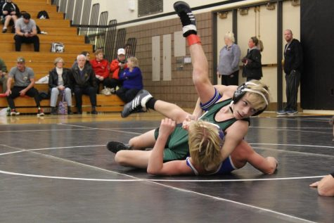 Freshman Carson Tridle pins his opponent during the freshman wrestling invitational. This meet was just for freshman on the JV team.
