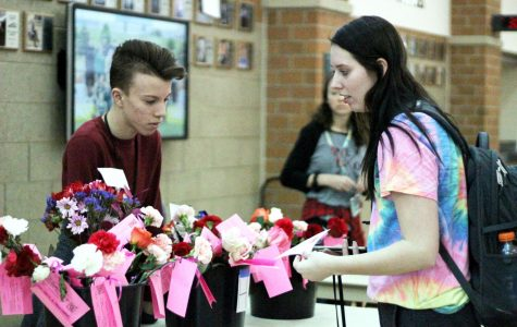 Flowers' sales are open from Feb. 3 through Feb. 13. Senior Lawson Horner helped with flowers' distribution on Valentine's Day last year.