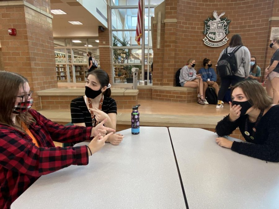 Seniors Jessica Hammers, Kailey Keith, and Rachel Hlavac interact with each other before class starts. Students are strongly encouraged to social distance when possible, and to use hand sanitizer as often as possible.