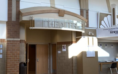 To attend the meeting, students enter through the doors in the Black Box and file into the socially distant auditorium through the back hallway.