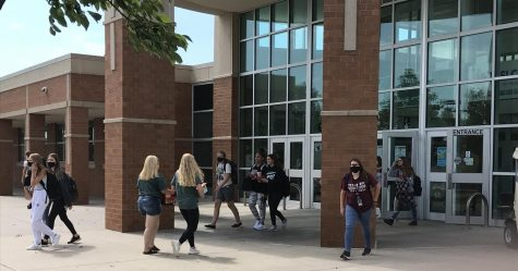 Students walk in and out of Lincoln Southwest High School. Students are required by LPS to wear face coverings in the building.