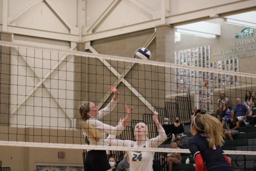 Senior Karli Symonsbergen and sophomore Maddie Rink prepare to hit the ball after a volley. Southwest lost to Norris on Thursday, Aug. 19 3-1.