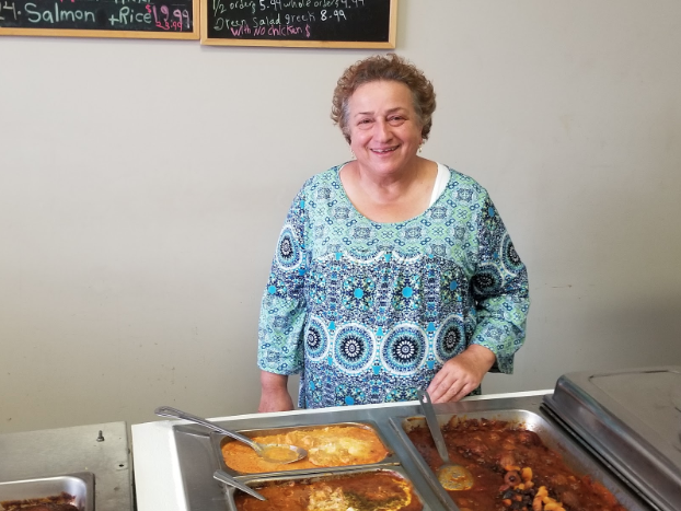 Narges Montazer standing in front of the buffet at her restaurant, Daffodil.