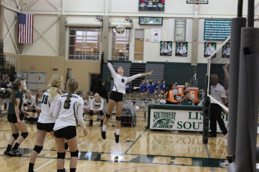Freshman Avery Tomlinson jumps to spike the ball in the match against North Star. The Hawks went on to lose the championship game to Southeast.