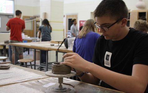 Beginner Potters Pinch Their First Pot
