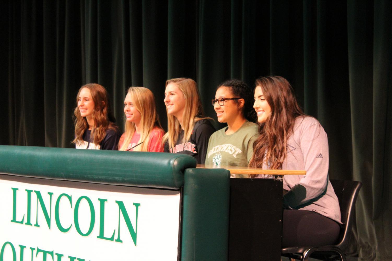 Seniors Emma Kauf, Berkeley Livingston, Hannah Kelle, Jaden Ferguson and Raegan Wells celebrate after committing to collegiate sports