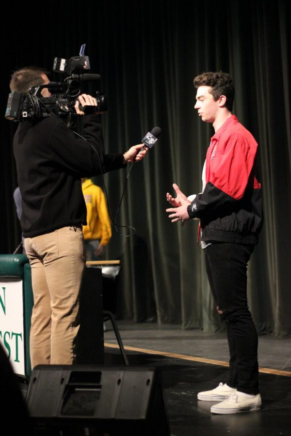 Senior+Caden+McCormack+is+interviewed+on+Feb.+6%2C+after+signing+with+4+fellow+students.+