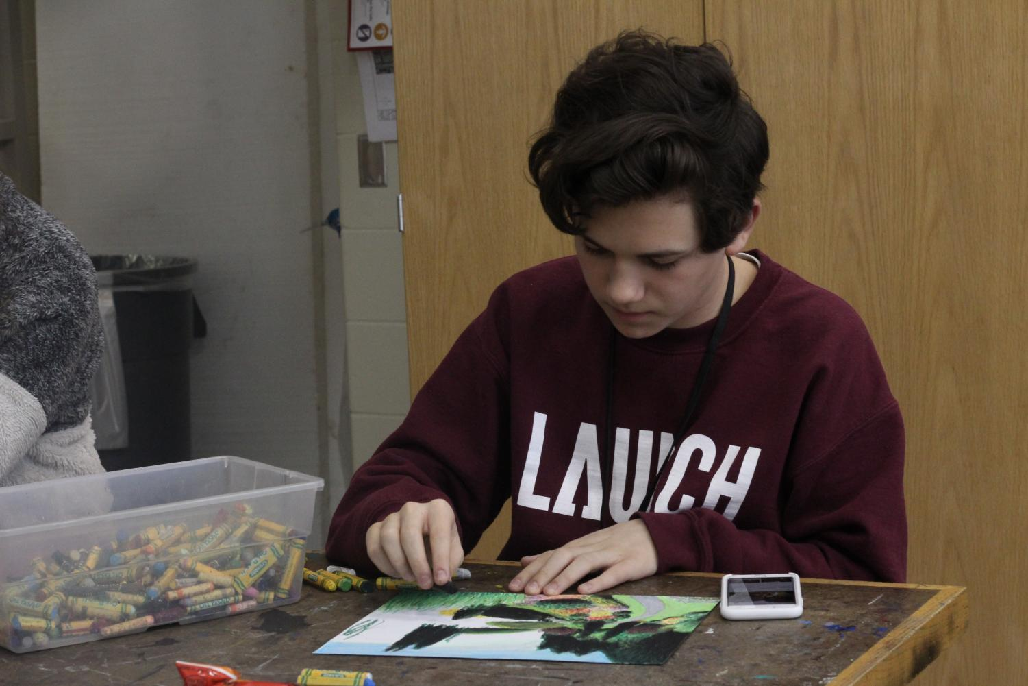 Freshman August Hudson working in Art Club. Art club meets every Thursday at 3:15 in room C106.