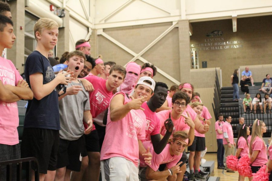 +People+dressed+up+for+the+pink-out+varsity+volleyball+game.