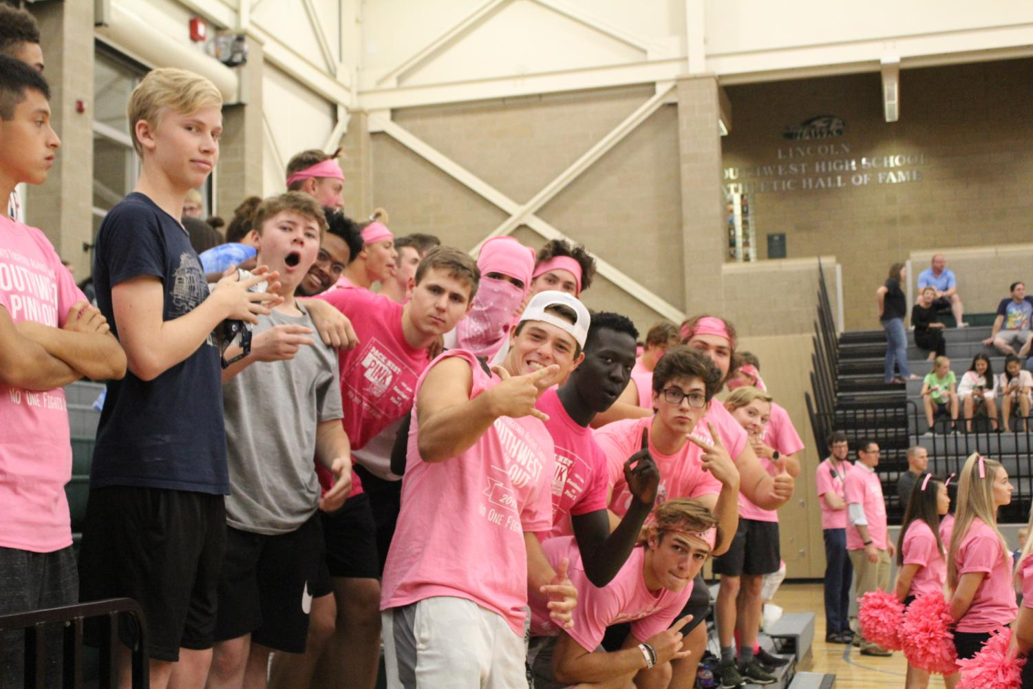People dressed up for the pink-out varsity volleyball game.