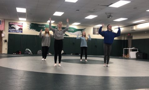 Sophomores Isabel Hung, Sierra Harrison, Sage Linder and Cecilia Sanchez perform their dance during Dance 101 class. The class is offered 3 terms a year in room D103 which is a wrestling gym.