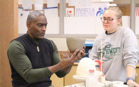 Art teacher, Willie Sapp instructs senior Rheyan Alwin during Pottery 1 class. Sapp won the Claes Nobel Educator of Distinction award on Jan. 16 2020.